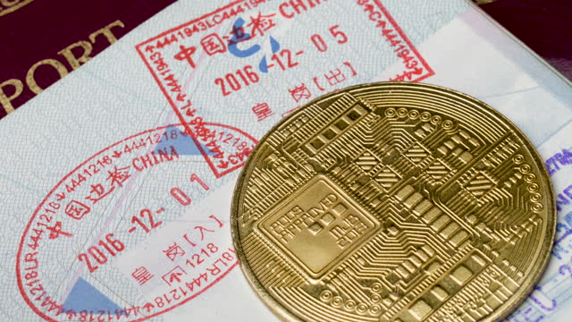 4k passport with china entry stamps and crypto currency. concept piece as china continues to ban cryptocurrency in favour of launching their own cbdc central bank digital currency the yuan - rules stock videos & royalty-free footage