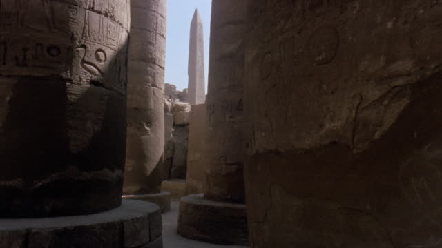 MS TS Past column in Luxor Temple to obelisks in sunlight/ Luxor, Egypt