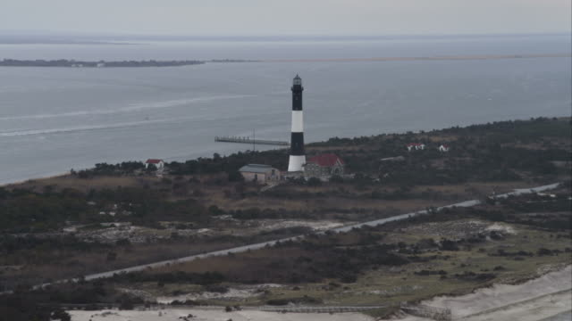 past fire island lighthouse on great south bay, long island new york. shot in november 2011. - atlantic islands stock videos & royalty-free footage