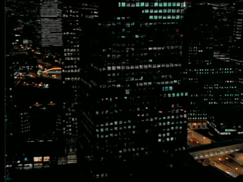 vídeos de stock, filmes e b-roll de aerial past mirrored office building at night / nyc - 2001