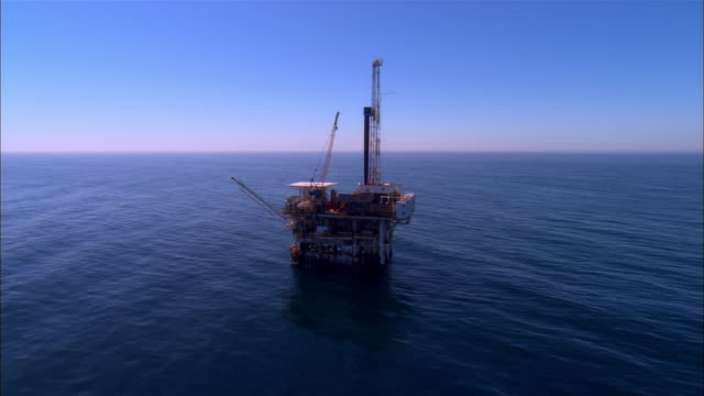 aerial past oil rig/ santa barbara, california  - oil rig stock videos and b-roll footage