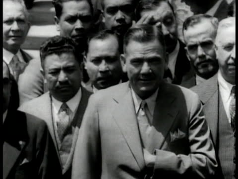 vídeos y material grabado en eventos de stock de past president of mexico founder of national revolutionary party atheist plutarco elias calles standing w/ group of unidentified men - ateísmo