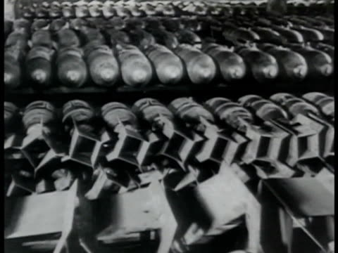 past rows of completed bombs. riussian workers rolling bomb into crates crating bombs. men working in yard of crated bombs stacked side by side &... - waffe stock-videos und b-roll-filmmaterial