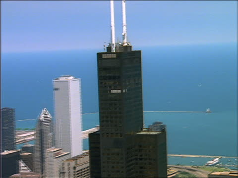 aerial past sears tower + surroundings bldgs / chicago - willis tower stock videos & royalty-free footage