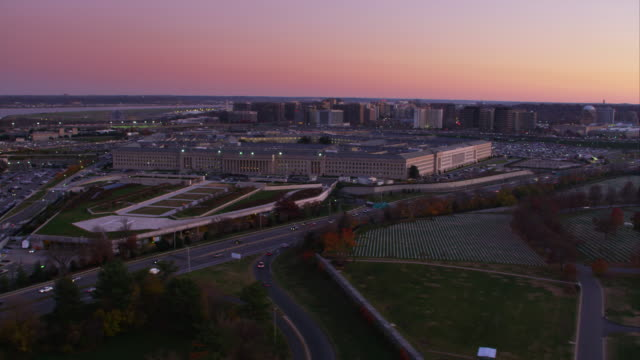Past the Pentagon at dusk with Arlington National Cemetery and Washington Boulevard in foreground, Pentagon City in background. Shot in 2011.
