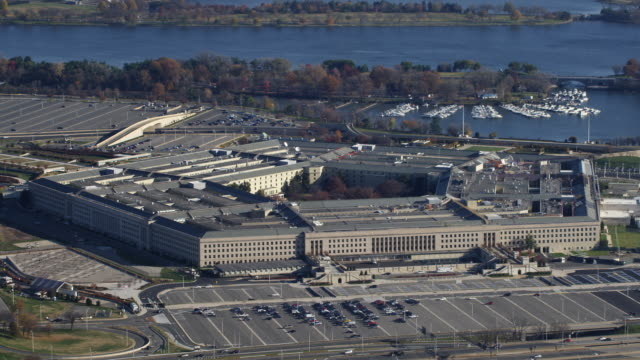 past the pentagon, zoom-out to reveal a glimpse of washington dc in background. shot in 2011. - the pentagon stock videos and b-roll footage