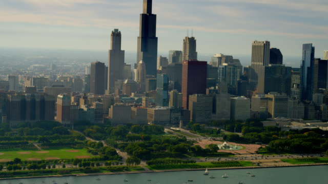 wide aerial side pov past waterfront and downtown chicago skyline - willis tower stock videos & royalty-free footage