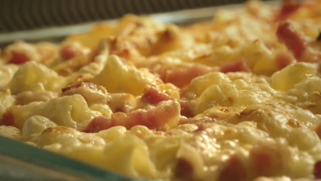 a pasta and bacon dish cooks in an oven. - bacon stock videos and b-roll footage