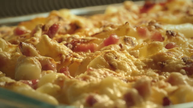 a pasta and bacon dish cooks in an oven. - gratin stock videos & royalty-free footage