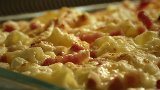 pasta and bacon in oven - gratin - close up - gratin stock videos & royalty-free footage