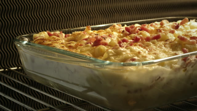 pasta and bacon in oven - gratin - gratin stock videos & royalty-free footage