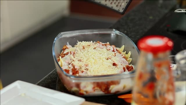 pasta and bolognese sauce gratin - cheese grating - gratin stock videos & royalty-free footage