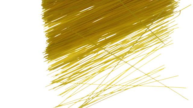 Pasta falling against White Background, Slow Motion