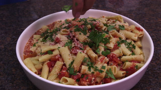 pasta in bowl final garnish & pick up cu - wiese stock videos & royalty-free footage