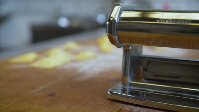 pasta maker and fresh pasta on wooden surface - comfort food stock videos & royalty-free footage