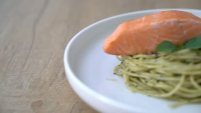 pasta spaghetti with pesto green and salmon