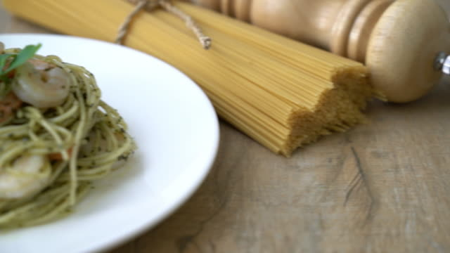 pasta spaghetti with pesto green and shrimps