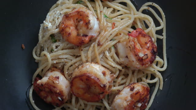 pasta with sauteed garlic prawns - seafood stock videos & royalty-free footage