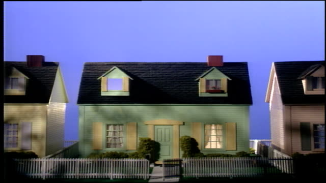 pastel colored model house with lights turning on and off in nyc - spielzeughaus stock-videos und b-roll-filmmaterial