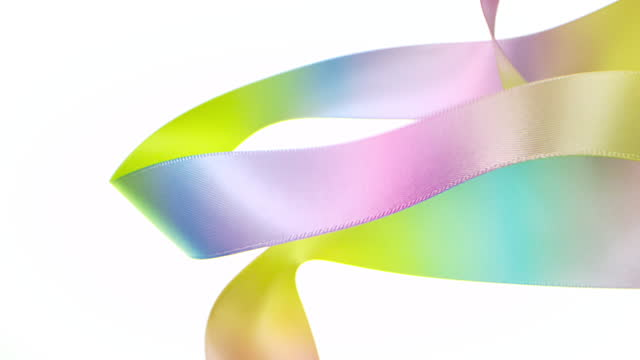 pastel colored ribbons on white background, for celebration events and party for new year, birthday party, christmas or any holidays, waiving and curling in super slow motion and close up - symbol stock videos & royalty-free footage