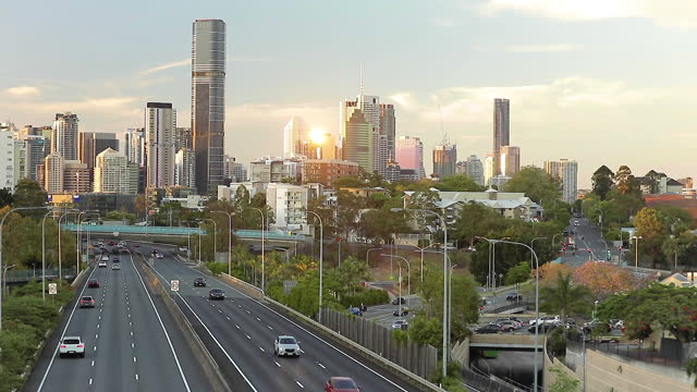 pastel light over the city with a highway and suburban streets at sunset - sustainable tourism stock videos & royalty-free footage