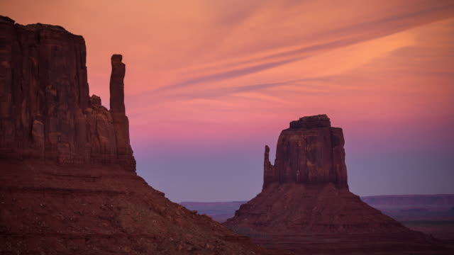 pastel sunset at monument valley - time lapse - red rocks stock videos and b-roll footage