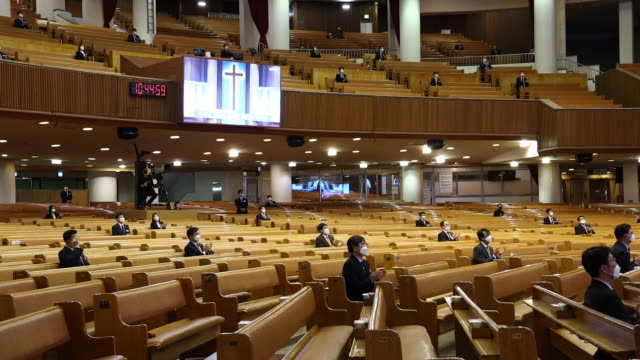 pastors and church employees wearing protective masks sit for sunday service streamed online at yoido full gospel church in seoul south korea on... - seoul stock videos & royalty-free footage