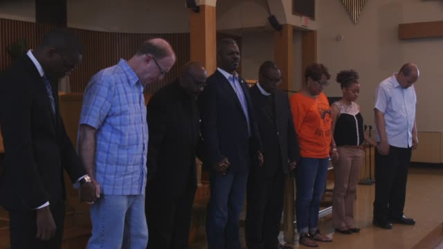 pastors and parishioners gathered at twelfth baptist church in roxbury for a vigil in solidarity with emanuel ame church in south carolina. produced... - pastor stock videos & royalty-free footage