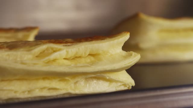 a pastry being baked and rising in the oven - pastry dough stock videos & royalty-free footage
