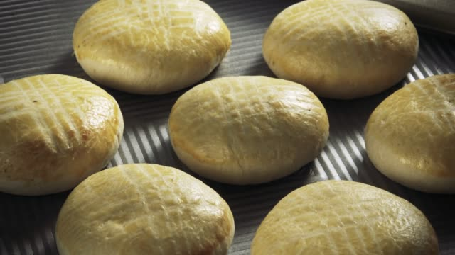 pastry buns baking in time lapse - pastry dough stock videos & royalty-free footage