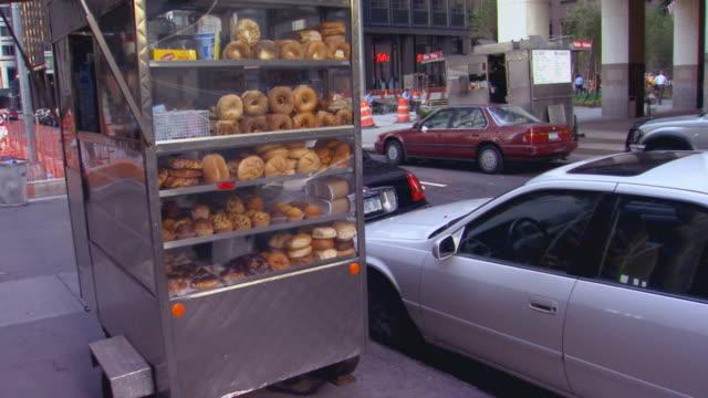 Pastry cart on side walk in New York (handheld shot)