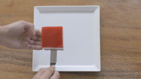 pastry chef places square of gourmet cake on square dessert dish - putting stock videos & royalty-free footage