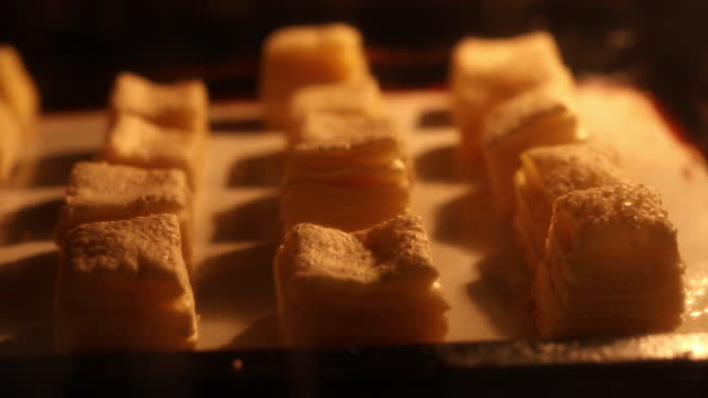 pastry dough snacks baking in oven time lapse - moving up stock videos & royalty-free footage
