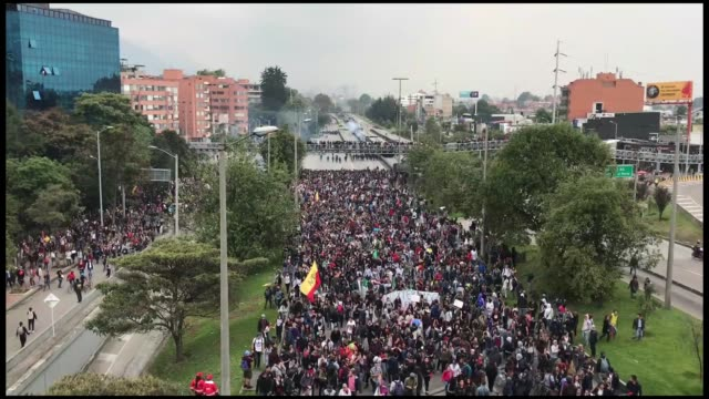 pat least three people were injured across colombia as police used tear gas to break up protesters demanding the government to increase education... - thursday stock videos and b-roll footage