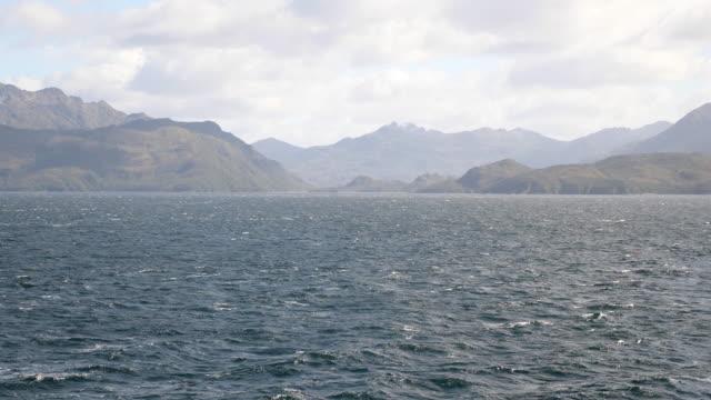 vídeos de stock, filmes e b-roll de patagonia mountain landscape from the sea - passear sem destino
