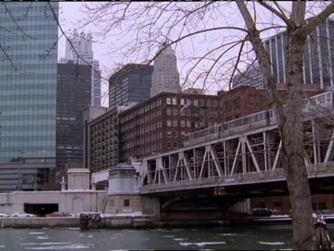 patches of ice float on a chicago river. - chicago 'l' stock videos & royalty-free footage