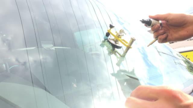 patching windshield crack - windschutzscheibe stock-videos und b-roll-filmmaterial