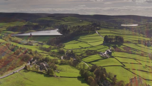 patchwork of fields and reservoirs near haworth, west yorkshire - drone shot - west yorkshire stock videos & royalty-free footage