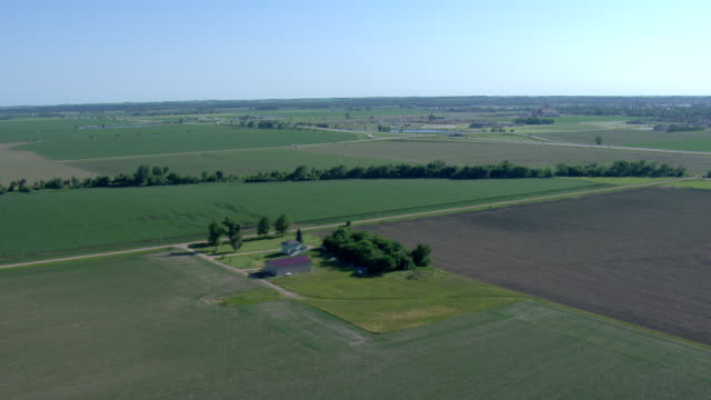 patchwork of fields, lakes and farm houses - nebraska stock-videos und b-roll-filmmaterial