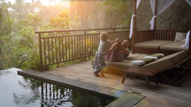 paternity leave at infinity pool - gender equality stock videos & royalty-free footage