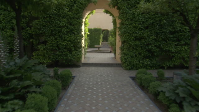 ms, zo, pov, path in courtyard garden, seville, andalusia, spain - garden path stock videos and b-roll footage
