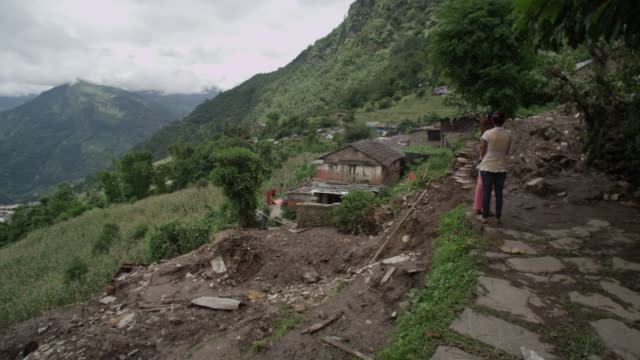 nepal - august 3, 2015: ms path of landslide, two women, destroyed houses - land stock videos & royalty-free footage