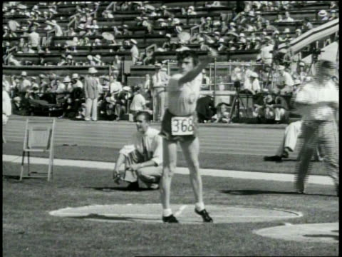 pathe news title card discus throw / women / won by lillian copeland us no 469 distance 133 ft 2 in new world's record / medium long shot of athlete... - television show stock videos & royalty-free footage