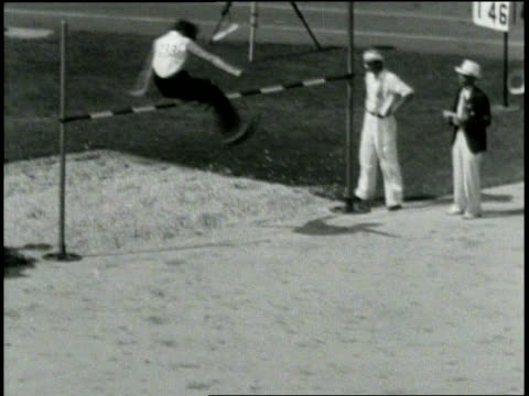 pathe news / title card: high jump women won by jean shiley, us no 480 height: 5ft 5-1/4 in new world's record / wide shot from ground of athlete... - other stock videos & royalty-free footage