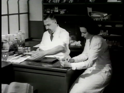 pathological laboratory sign pathologist assistant at desk examining gallbladder cu tweezers lifting gallstones from dissected gallbladder bg placing... - 1948 stock videos and b-roll footage