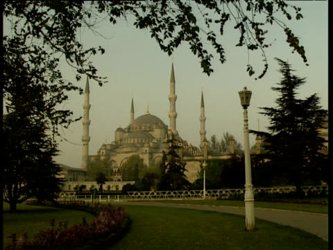Pathway through park to Blue Mosque with domes and minarets Istanbul