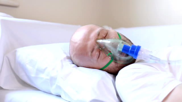 patience sleeping in hospital - oxygen mask stock videos and b-roll footage