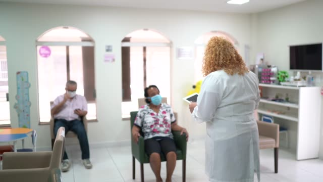 patient arriving at medical clinic and being called by the doctor - secretary stock videos & royalty-free footage