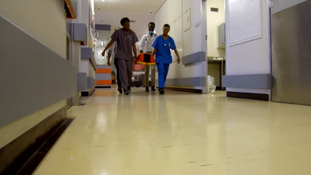 patient arriving to the hospital on a spine board - casualty stock videos & royalty-free footage