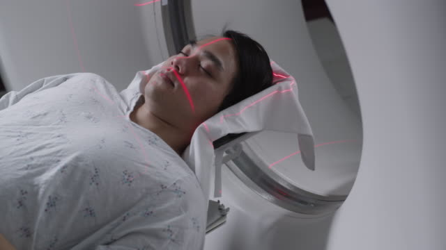 ms patient being prepared for medical scan / payson, utah, usa - ペイソン点の映像素材/bロール